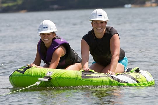 Lisa and Joy on the lake with hard hats